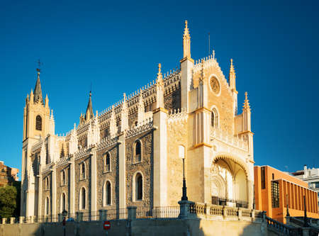 gothic church: View of the San Jeronimo el Real (St. Jerome Royal Church) in evening sun. Roman Catholic church located in central Madrid, Spain. Blue sky in background.