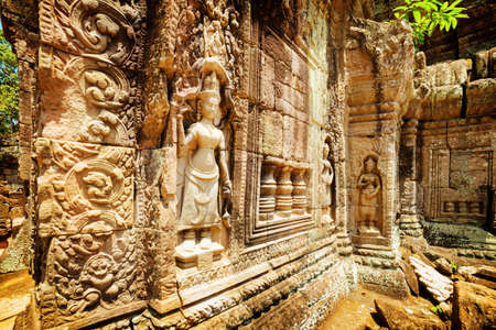 temple tower: Wall with bas-relief of ancient Ta Som temple in amazing Angkor, Siem Reap, Cambodia. Enigmatic Angkor is a popular tourist attraction. Stock Photo
