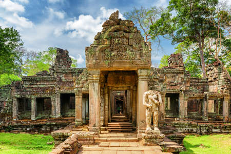 temples: Mossy entrance to ancient Preah Khan temple in Angkor, Siem Reap, Cambodia. Mysterious Preah Khan temple has been swallowed by jungle. Enigmatic Preah Khan is a popular tourist attraction. Stock Photo