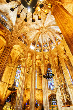 barcelona cathedral: BARCELONA, SPAIN - AUGUST 21, 2014: Gothic arches in interior of the Cathedral of the Holy Cross and Saint Eulalia (Catedral de la Santa Cruz y Santa Eulalia), also known as Barcelona Cathedral.