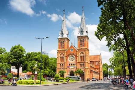 HO CHI MINH, VIETNAM - APRIL 30, 2015: Saigon Notre-Dame Cathedral Basilica on blue sky background in Ho Chi Minh city, Vietnam. Ho Chi Minh is a popular tourist destination of Asia. 新闻类图片