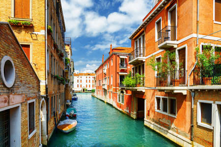 marin: Beautiful view of the Rio Marin Canal and colorful facades of old houses from the Ponte de la Bergami in Venice, Italy. Venice is a popular tourist destination of Europe. Stock Photo