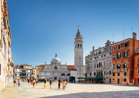 maria: The Church of Santa Maria Formosa on square of the same name in Venice, Italy. View of bell-tower and colorful facades of old medieval houses. Venice is a popular tourist destination of Europe. Editorial