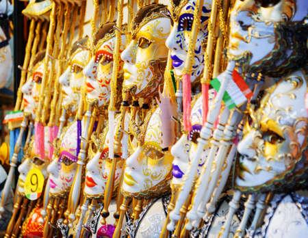 fullface: Authentic and original Venetian full-face masks for Carnival in Venice, Italy. Ornate colorful masks in souvenir shop on the Rialto Bridge Ponte di Rialto.