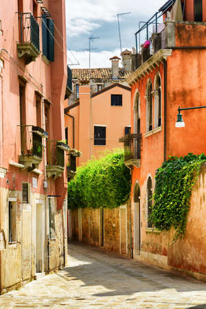 old houses: Scenic colorful facades of old houses on street Calle Gradisca Cannaregio in Venice, Italy. Venice is a popular tourist destination of Europe. Stock Photo