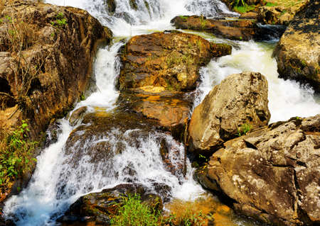 waterfall in the city: Close-up view of a cascade on the Datanla waterfall in Da Lat city (Dalat), Vietnam. Da Lat and the surrounding area is a popular tourist destination of Asia.