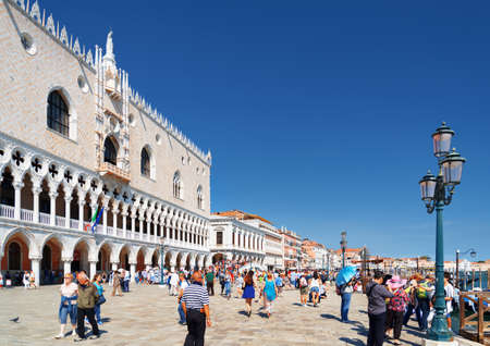ducale: View of the Doges Palace Palazzo Ducale and the Riva degli Schiavoni in Venice. Venice is a popular tourist destination of Europe. Editorial
