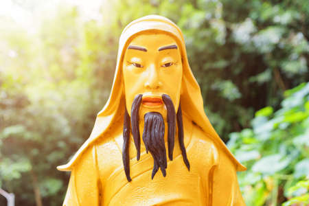monastery nature: Closeup view of Golden Buddha statue in the Ten Thousand Buddhas Monastery on nature background in Hong Kong. Hong Kong is popular tourist destination of Asia.