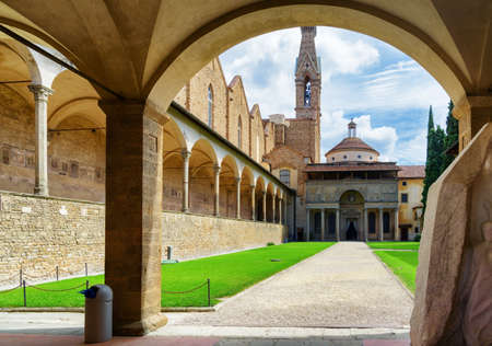 basilica: Courtyard of the Basilica di Santa Croce (Basilica of the Holy Cross) in Florence, Tuscany, Italy. Bell tower of the church on sky background. Florence is a popular tourist destination of Europe.