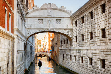 View of the Bridge of Sighs (Ponte dei Sospiri) and the Rio de Palazzo o de Canonica Canal from the Riva degli Schiavoni in Venice, Italy. The Ponte de la Canonica is visible in background. Stock Photo