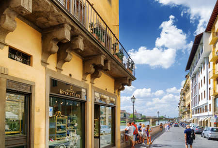 trinita: FLORENCE, ITALY - AUGUST 25, 2014: Jewelry shop and view of the Lungarno degli Archibusieri in Florence. The Ponte Santa Trinita (Holy Trinity Bridge) over the Arno River is visible in background. Editorial