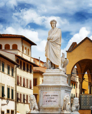 dante alighieri: White marble statue of Dante Alighieri on the Piazza Santa Croce in Florence, Tuscany, Italy. Florence is a popular tourist destination of Europe. Stock Photo