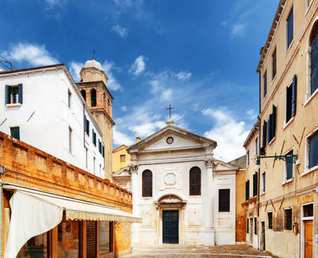 alley: View of the San Simeone Profeta church in Venice, Italy. Blue sky in background. Venice is a popular tourist destination of Europe. Stock Photo