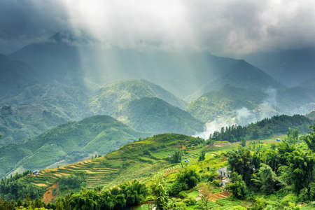 lien: Amazing view of rays of sunlight through storm clouds in the Hoang Lien Mountains of Sapa District, Lao Cai Province, Vietnam. Sa Pa is a popular tourist destination of Asia.