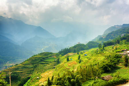 lien: Beautiful view of rice terraces at highlands. Sapa District, Lao Cai Province, Vietnam. Sa Pa is a popular tourist destination of Asia. The Hoang Lien Mountains are visible in background.