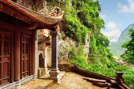 destination scenic: Scenic view of the Bich Dong Pagoda at Ninh Binh Province in Vietnam. Ancient Buddhist cave temple is a popular tourist destination of Asia.