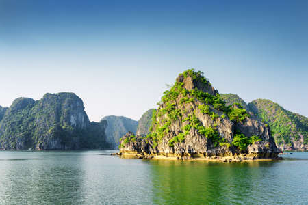 destination scenic: Scenic view of the Halong Bay (Descending Dragon Bay) at the Gulf of Tonkin of the South China Sea, Vietnam. Landscape formed by karst towers-isles. The Ha Long Bay is a popular tourist destination.