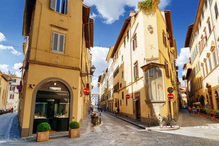 alley: FLORENCE, ITALY - AUGUST 25, 2014: Crossroad of the Via della Spada, the Via del Sole and the Via delle Belle Donne in Florence, Tuscany, Italy. Florence is a popular tourist destination of Europe.