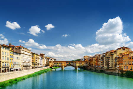 medieval: Medieval bridge Ponte Vecchio (Old Bridge) and the Arno River in Florence, Tuscany, Italy. View from the Ponte Santa Trinita (Holy Trinity Bridge). Florence is a popular tourist destination of Europe.