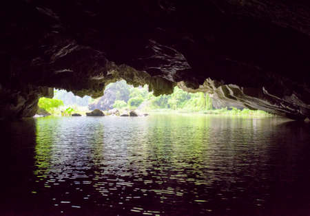 ngo: View of the Ngo Dong River from natural karst grotto at the Tam Coc portion, Ninh Binh Province, Vietnam. The river flows through cave. The Tam Coc is a popular tourist attraction in Vietnam.