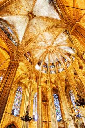 santa cross: BARCELONA, SPAIN - AUGUST 21, 2014: Gothic arches in interior of the Cathedral of the Holy Cross and Saint Eulalia (Catedral de la Santa Cruz y Santa Eulalia), also known as the Barcelona Cathedral.