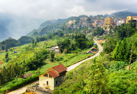lao: Bending road in Sapa town at highlands of Lao Cai Province, Vietnam. Sa Pa is a popular tourist destination of Asia.