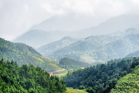 lien: Scenic view of the Hoang Lien Mountains. Sapa District, Lao Cai Province, Vietnam. Sa Pa is a popular tourist destination of Asia.