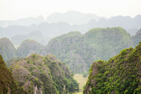 tam: Scenic view of myriad karst mountains at the Tam Coc portion, Ninh Binh Province, Vietnam. Ninh Binh Province is a popular tourist destination of Asia.