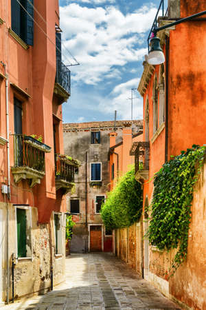 italy street: Colorful facades of old houses on street Calle Gradisca Cannaregio in Venice, Italy. Venice is a popular tourist destination of Europe. Stock Photo