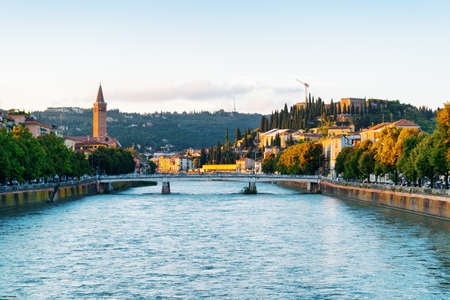 Beautiful view of the Ponte Nuovo (New Bridge) over the Adige River in Verona (Italy) at dawn. Verona is a popular tourist destination of Europe.