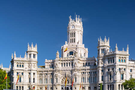 palacio: The Cybele Palace (Palacio de Cibeles) or the Palace of Communication in Madrid, Spain. Blue sky in background. Madrid is a popular tourist destination of Europe.