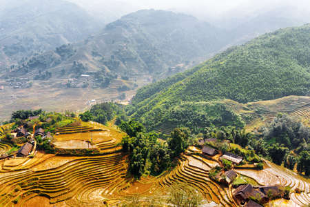 lien: Top view of village houses and terraced rice fields in the Hoang Lien Mountains. Sa Pa District, Lao Cai Province, Vietnam. Sapa is a popular tourist destination of Asia.