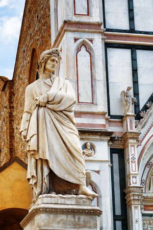 dante alighieri: Statue of Dante Alighieri in front of the Basilica di Santa Croce (Basilica of the Holy Cross) on square of the same name in Florence, Italy. Florence is a popular tourist destination of Europe.