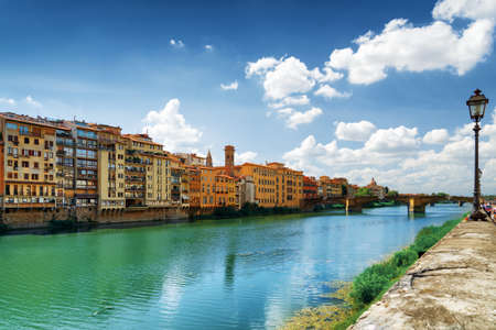 old bridge: View of the Ponte Santa Trinita (Holy Trinity Bridge) in Florence, Tuscany, Italy. Facades of old medieval houses on waterfront of the Arno River. Florence is a popular tourist destination of Europe.