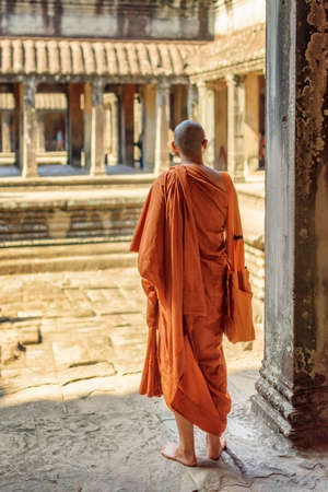 buddhist's: Buddhist monk exploring courtyards of ancient temple complex Angkor Wat in Siem Reap, Cambodia. Amazing Angkor Wat is a popular destination of tourists and pilgrims.