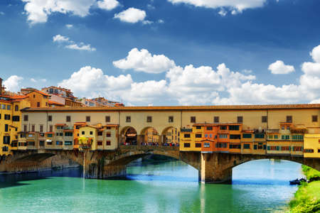 Medieval stone bridge Ponte Vecchio (Old Bridge) over the Arno River and the Vasari Corridor in Florence, Tuscany, Italy. Florence is a popular tourist destination of Europe.