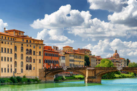 trinita: View of the Ponte Santa Trinita (Holy Trinity Bridge) over the Arno River in Florence, Tuscany, Italy. Dome of the Church of Saint Fridianus (San Frediano in Cestello) is visible in background.