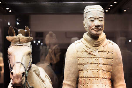 huang: XIAN, SHAANXI PROVINCE, CHINA - OCTOBER 28, 2015: Cavalryman with his saddled war-horse of the Terracotta Army, the Qin Shi Huang Mausoleum of the First Emperor of China.