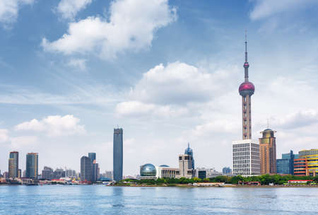 shanghai pudong skyline: Scenic view of the Pudong New Area (Lujiazui) from the Bund across the Huangpu River in Shanghai, China. The Oriental Pearl Tower is visible at right. Shanghai is a popular tourist destination of Asia Stock Photo