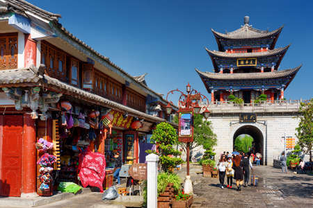 towns: DALI, YUNNAN PROVINCE, CHINA - OCTOBER 21, 2015: View of the Wuhua Tower and souvenir shops in Dali Old Town. The Wuhua Tower is central landmark of the ancient city.
