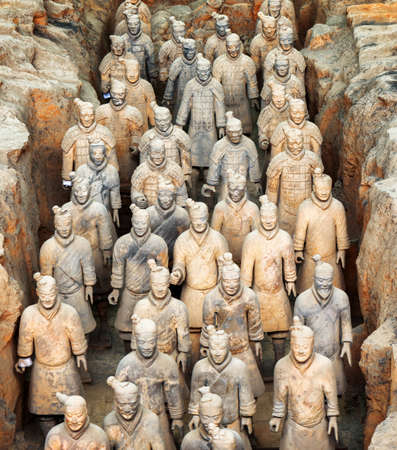terra cotta: XIAN, SHAANXI PROVINCE, CHINA - OCTOBER 28, 2015: Terracotta infantrymen of the famous Terracotta Army inside the Qin Shi Huang Mausoleum of the First Emperor of China. Editorial