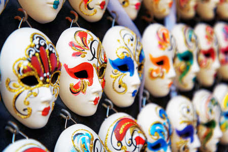 fullface: VENICE, ITALY - AUGUST 24, 2014: Authentic and original Venetian full-face masks for Carnival in street shop of Venice, Italy. Handmade masks with ornate design and bright colors.