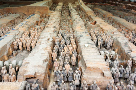 huang: XIAN, SHAANXI PROVINCE, CHINA - OCTOBER 28, 2015: View of corridors with ranks of terracotta soldiers. The Terracotta Army, the Qin Shi Huang Mausoleum of the First Emperor of China.