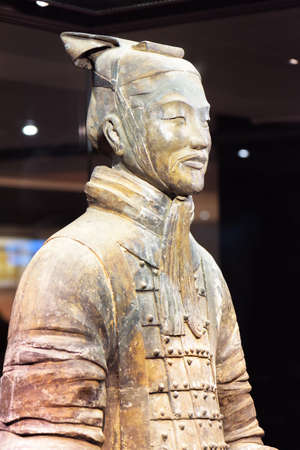 huang: XIAN, SHAANXI PROVINCE, CHINA - OCTOBER 28, 2015: Closeup view of middle-ranking officer of the Terracotta Army, the Qin Shi Huang Mausoleum of the First Emperor of China.