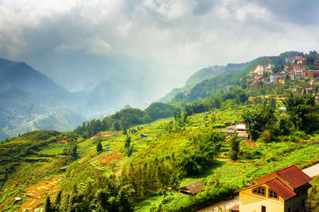 lien: Beautiful view of rice terraces and Sapa town at highlands of Lao Cai Province, Vietnam. Sa Pa is a popular tourist destination of Asia.