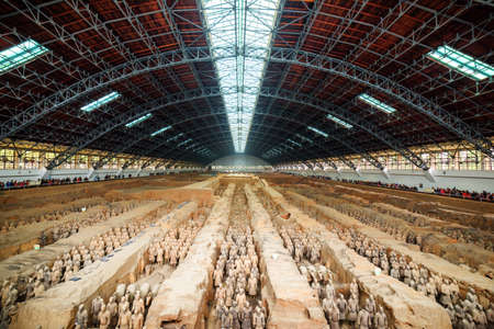 imperialism: XIAN, SHAANXI PROVINCE, CHINA - OCTOBER 28, 2015: Main view of corridors with ranks of terracotta soldiers. The Terracotta Army, the Qin Shi Huang Mausoleum of the First Emperor of China.