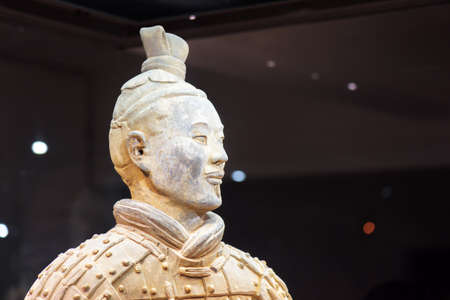 XI'AN, SHAANXI PROVINCE, CHINA - OCTOBER 28, 2015: Closeup view of head of the Terracotta Army archer, the Qin Shi Huang Mausoleum of the First Emperor of China.
