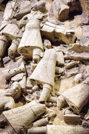 huang: XIAN, SHAANXI PROVINCE, CHINA - OCTOBER 28, 2015: Remains of terracotta soldiers of the famous Terracotta Army at excavation pit, the Qin Shi Huang Mausoleum of the First Emperor of China.