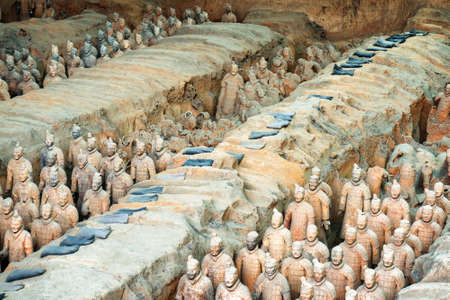 imperialism: XIAN, SHAANXI PROVINCE, CHINA - OCTOBER 28, 2015: The Terracotta Warriors and remains of sculptures in corridors inside the Qin Shi Huang Mausoleum of the First Emperor of China.