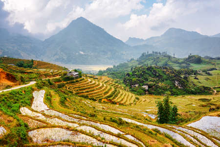 destination scenic: Scenic view of rice terraces filled with water at highlands of Sapa District in autumn. Lao Cai Province, Vietnam. Sa Pa is a popular tourist destination of Asia. Stock Photo